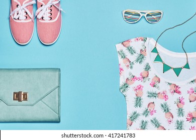 Summer hipster Fashion girl clothes set, accessories. Stylish gumshoes, trendy clutch, necklace, sunglasses. Minimal urban woman outfit. Pastel