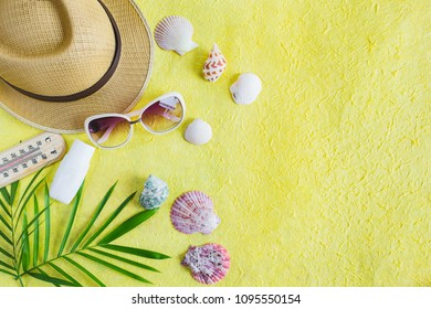Summer holiday background, Beach accessories on yellow texture, Vacation and travel items