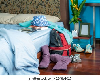 Summer holiday backpack in bedroom, concept of dream destination