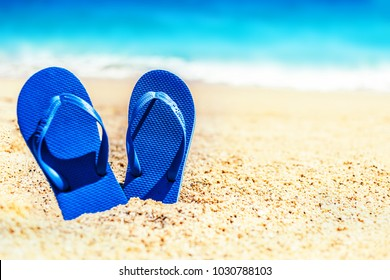 Summer holiday beach background with flip flops on a tropical beach. Slippers from a sand on a beach, relax concept