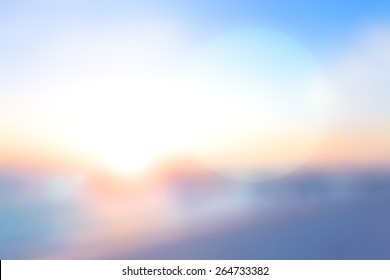 Summer holiday concept: Abstract bokeh light and blurry beach sunrise background