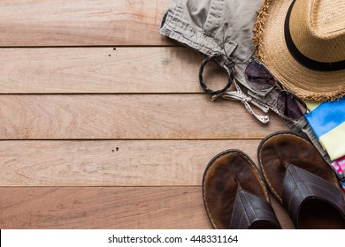 Summer holiday concept, men's accessories and travel items on wooden board, flat lay, top view background
