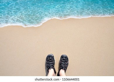 Summer holiday concept , top view selfie of feet in black sandals on beach
