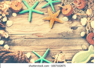 Summer holiday frame with seashells and fishing net. Vacation background with copy space