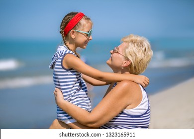 Summer holiday. Grandmother with granddaughter having fun outdoors.