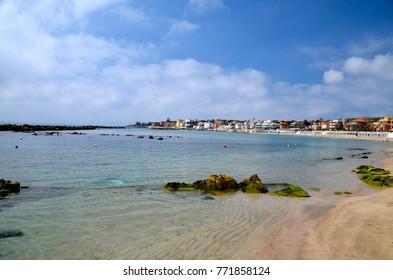 Summer holiday on coastal stones of the Italian Santa Marinella