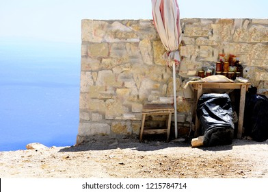summer holiday on the road concept - old wall with artisanal albanian honey  and sea panorama on the background