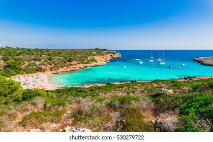 Summer holiday, sand beach of Cala Varques, Majorca beautiful bay, Mediterranean Sea Spain.