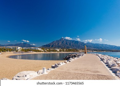 Summer holiday scenery, sandy beach by the blue sea, in Marbella resort on Costa del Sol in Spain