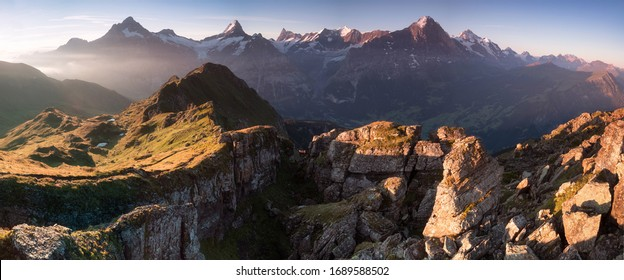 Summer holiday season. Sunrise view on Bernese range above Bachalpsee lake. Highest peaks Eiger, Jungfrau and Schreckhorn in famous location. Switzerland alps, Grindelwald valley. Travel background - Shutterstock ID 1689588502