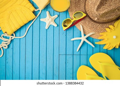 Summer holiday vacation background with beach accessories on wooden table. Top view from above