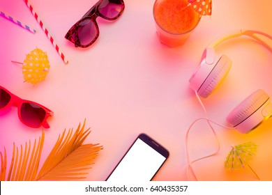 Summer holiday (vacation) relaxation concept. Mobile phone (smartphone), headphones, sunglasses and fruity drink from above (top view, flat lay). Colorful background with free text (copy) space.