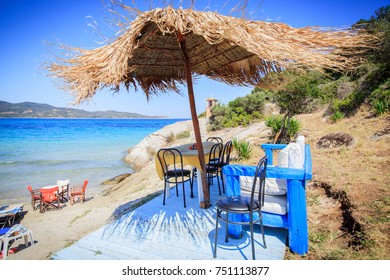 Summer holiday vacation, sun umbrella and chair, beautiful view on beach and sea.