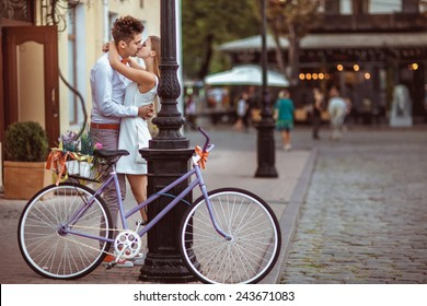 Summer holidays, bikes, love, wedding- couple with bicycles in the city.