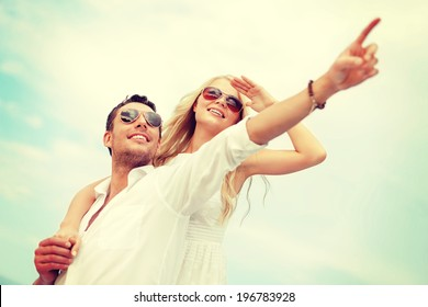 summer holidays, celebration and dating concept - couple at seaside