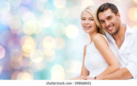 summer holidays, dating, love, romance and people concept - happy couple hugging fun over blue holidays lights background