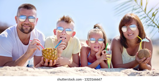 Summer holidays. Family having fun on the beach at the day time.