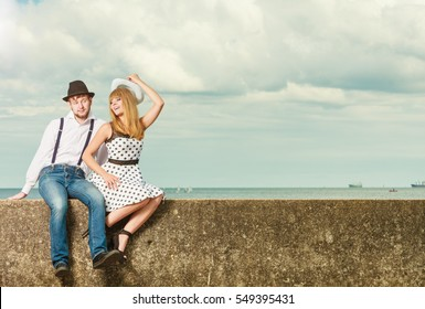 Summer holidays love relationship and dating concept - romantic playful couple retro style flirting on sea shore