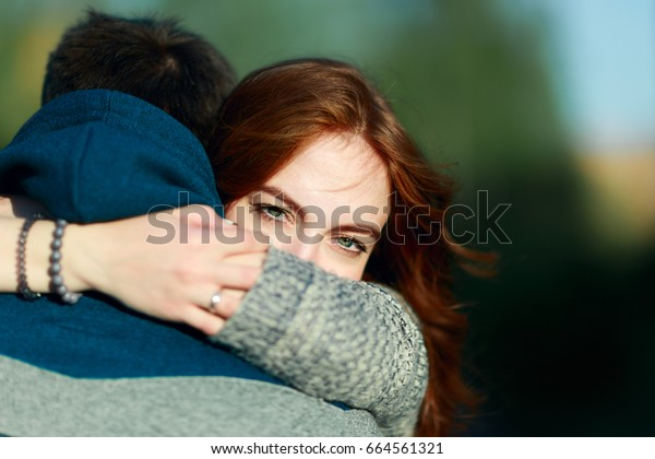 summer holidays, love, romance and people concept - young couple hugging before parting