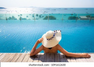 Summer holidays on the beach., Portrait of woman relaxing in swimming pool.