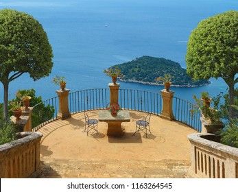 Summer Holidays on a terrace in mediterranean landscape overlooking the sea