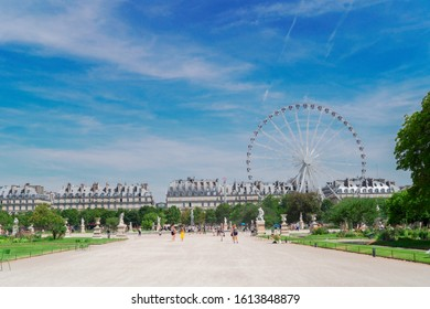 Summer holidays in Paris. Tuileries gardens with ferry wheel in front of Louvre palace, Paris France.