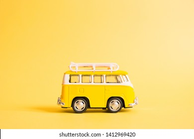 Summer holidays poster with retro yellow bus van on yellow background. Funny retro car with surfboard. Summer travel