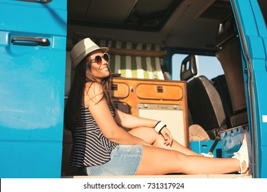 summer holidays, road trip, travel and people concept, young woman resting in minivan car