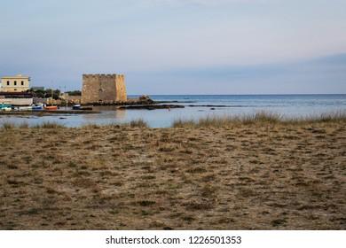 Summer holidays in the seaside resort of Torre Santa Sabina beach in Puglia (Italy).