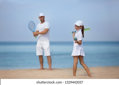 Summer holidays. Sport. Lifestyle. Father with daughter playing tennis