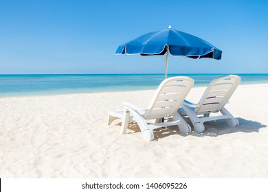 Summer holidays with sun chairs and sunshade at the beach