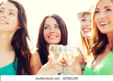 summer holidays, vacation and celebration - girls with champagne glasses
