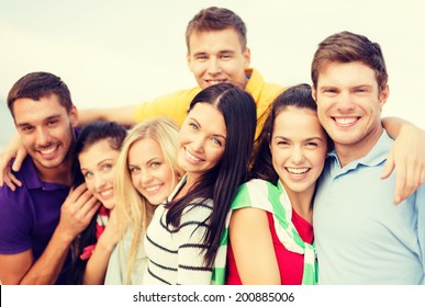 summer, holidays, vacation and happiness concept - group of friends having fun on the beach