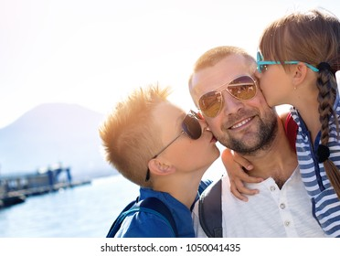 Summer holidays.Father with children are waiting summer sea vacation