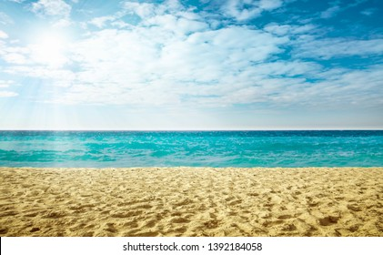 Summer hot sand on beach. Ocean landscape with blue sky. Sunny day and sun light. Free space for your decoration.