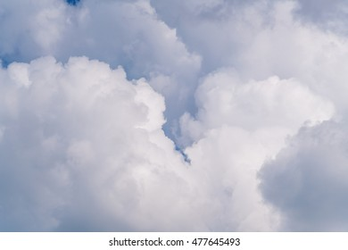 Summer idyllic cloudscape with clear white clouds in blue sky