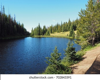 Summer at Lake Irene in the Rocky Mountains National Park in Colorado.  There is a clear blue sky overhead.
