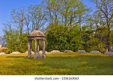 Summer landscape with ancient stone gazebo in the public park in Girona, Catalonia, Spain