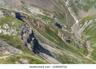 Summer landscape with beautiful unique rock formations geological folding around Livigno, Italy, sunny day