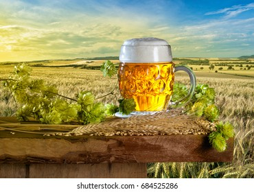 Summer Landscape with Beer Glass and Hops
