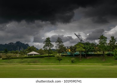 Summer landscape with black storm clouds in sky