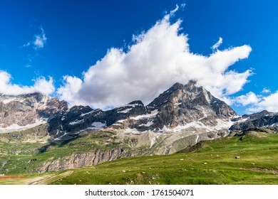 Summer landscape of cervino mount in the valtournenche, Italy. Meadow, nature, and a beautiful cloudy sky.