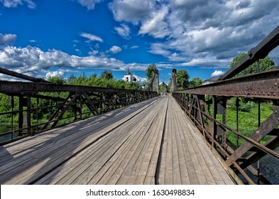 Summer landscape with chain cable-stayed bridge and  St. Nicholas Church (Ostrov, Pskov oblast, Russia) - Shutterstock ID 1630498834