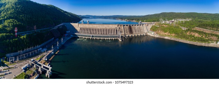 Summer landscape a dam of hydroelectric power station in Siberia on the Yenisei River, shooting from air
