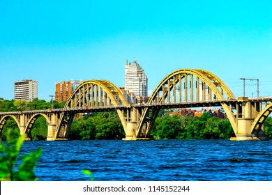 Summer Landscape of the Dnepr city with a railway bridge across the Dnieper river and a view of the skyscrapers and towers   of Dnepropetrovsk  (Dnipropetrovsk, Dnepr), Ukraine