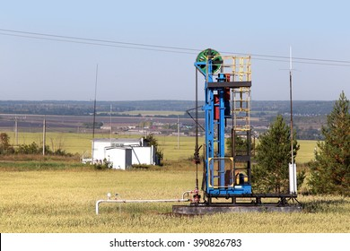 summer landscape drilling rig for oil field on a sunny day