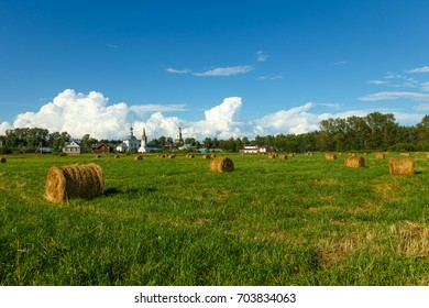 Summer landscape in field with haystacks in centre of Suzdal