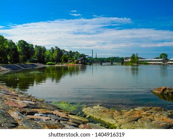Summer landscape in FInland, Helsinki. Beautiful lake with tree reflections and blue sky. Summer in Finland.