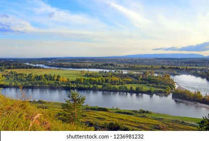 Summer landscape. The floodplain of the river from the high Bank. Uda River, Siberia, Russia.