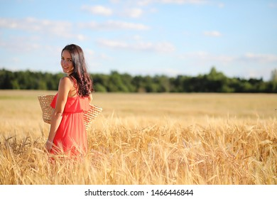 Summer landscape and a girl on a nature walk in the countryside.